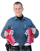 A UB Police Officer holding high heel shoes.