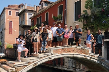 The UB study abroad group on a bridge in Venice.