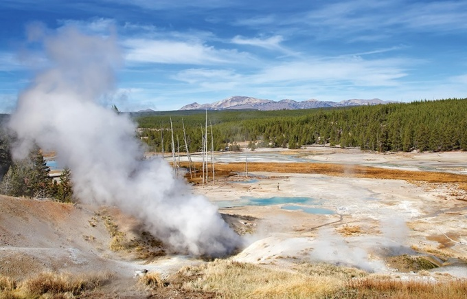 Steam erupts from Norris Geyser Basin, the hottest area of Yellowstone Caldera, a supervolcano.
