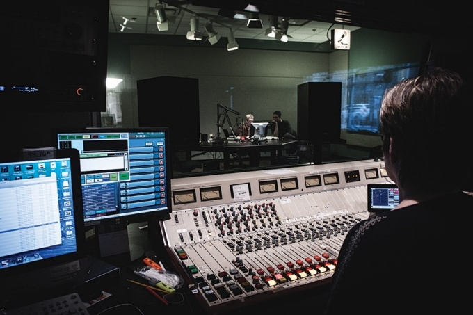 Terry Gross (at desktop computer) in the WHYY-FM studios.