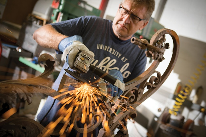 Brian Koyn grinds years of rust off the newly discovered lantern.