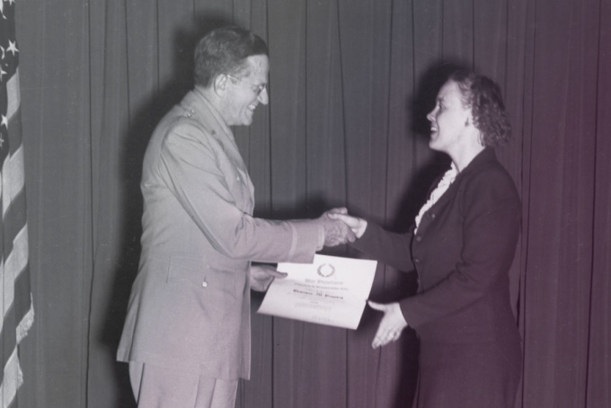 Receiving the Exceptional Civilian Service Award from Brig. Gen. Paul Everton Peabody in 1946.