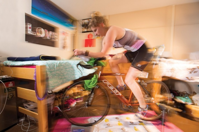 Julia Slyer set up a stationary bicycle trainer in her dorm room.