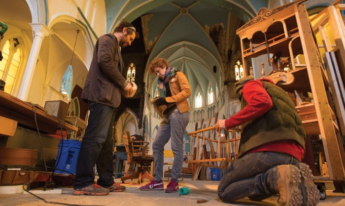 Dennis Maher tackling a project with carpentry assistants Sarah Campbell (middle) and Viktoria Ciostek (right) at Maher's workshop—a repurposed church.