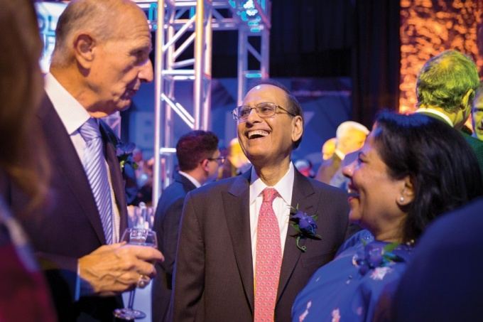 President Tripathi and his wife, Kamlesh, celebrate the campaign kickoff with Honorary Campaign Co-Chair Jeremy Jacobs.