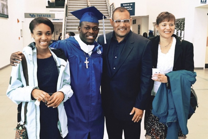 "Branden Oliver on graduation day with UB running backs coach Matt Simon. With them are Simon's wife Lisa (far right), and stepdaughter Madison Wells-James—""Bo's biggest fans, win or lose,"" says Simon."