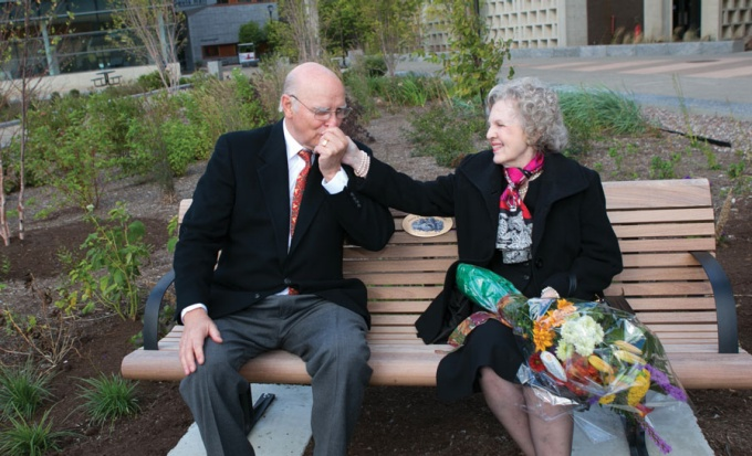 Norman McCombs and his wife Grace on a bench in Grace Plaza