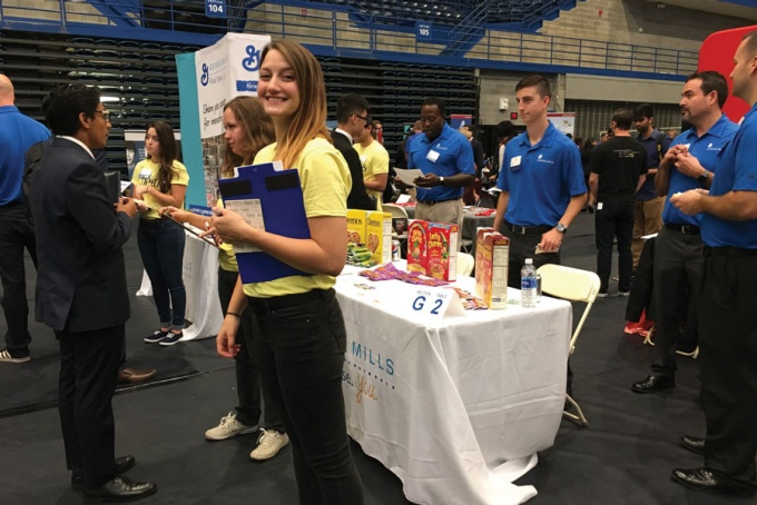 Photo of General Mills employees in Alumni Arena during a career fair