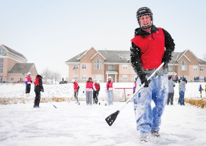 Student's playing pond hockey on Lake Lasalle, North Campus.