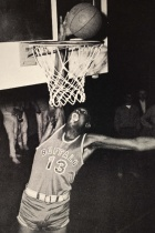 Antique photo of UB basketball player Jim Horne making a basket