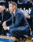 Coach Nate Oats on the court during a game