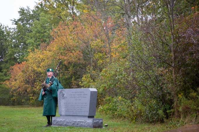 Bagpiper at Erie County Poorhouse monument