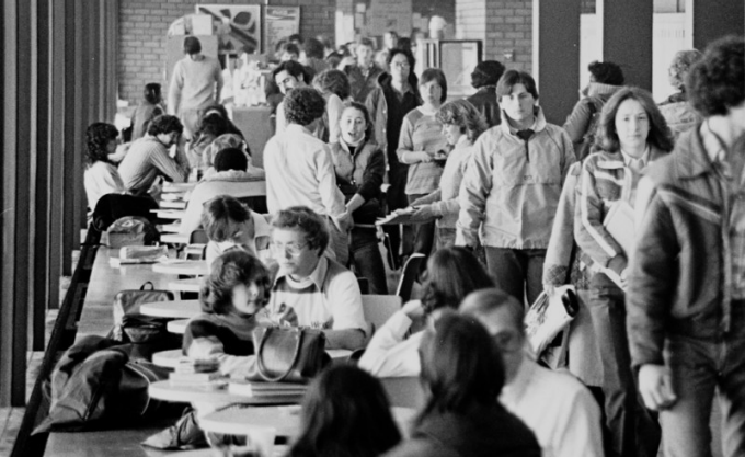 Students walking through halls in Baldy on the North Campus spine circa 1970s.
