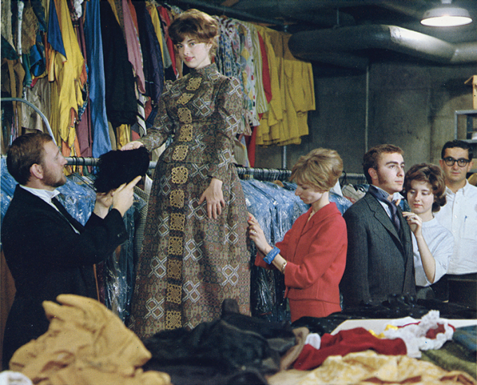 Esther Kling fitting actors in costumes