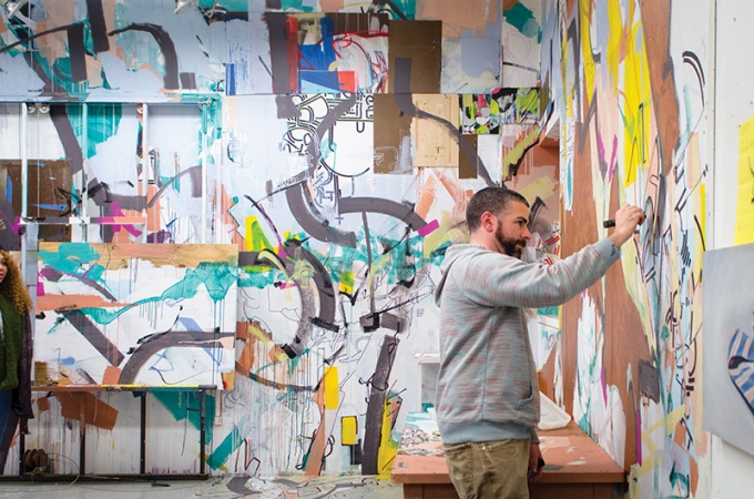 Nate Hodge adds another layer to his live-painting installation.