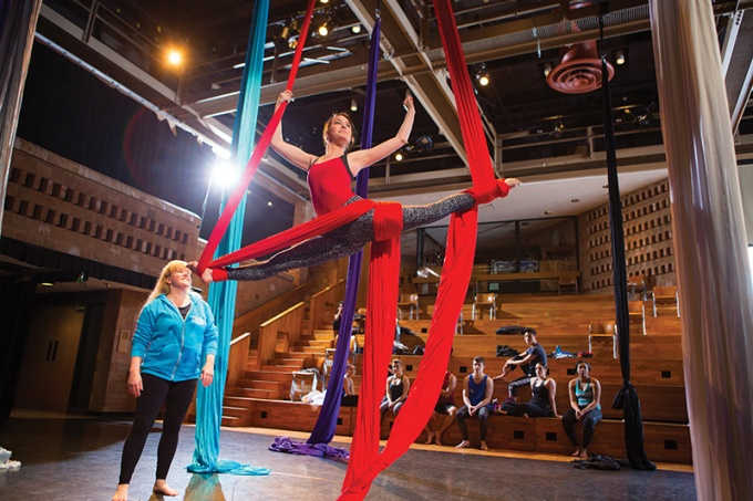 Kathleen Golde, an adjunct instructor and professional dancer, instructing a student in her aerial arts course at UB.