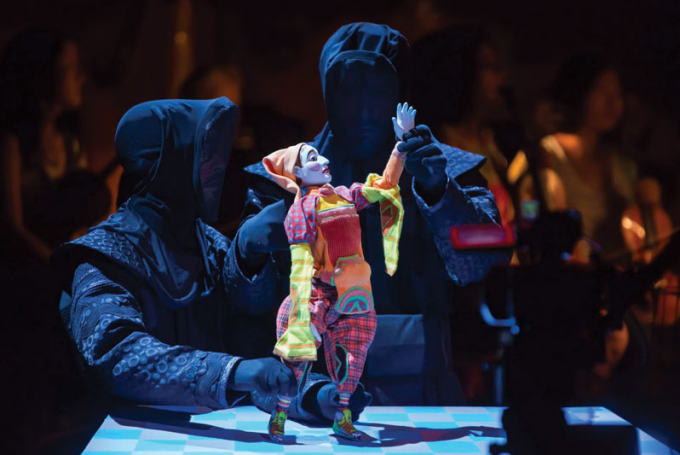 "Vincent McCloskey (left) and William Da Silva (right), puppeteering in ""Petrushka."""
