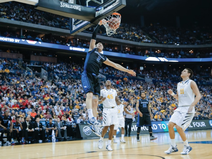 Buffalo native Will Regan slam dunking during UB's NCAA Tournament game.