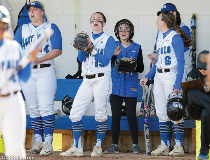 Maddie Nadrich cheers on her teammates in the dugout during a UB softball game in the spring.
