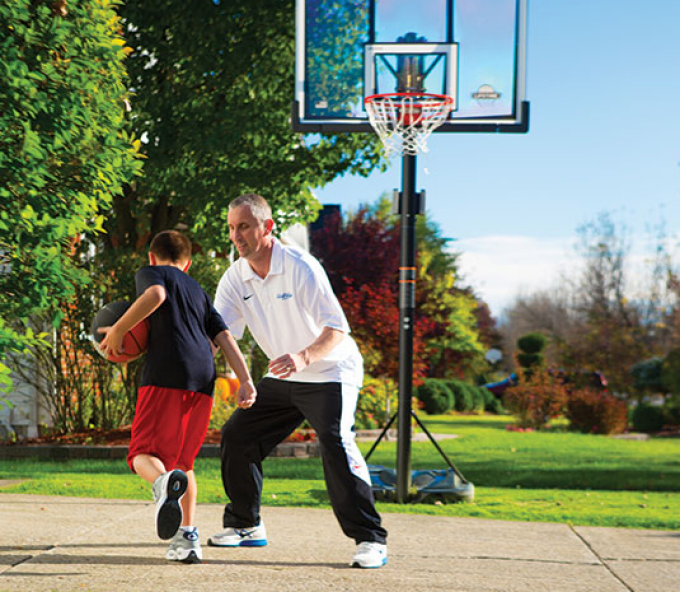 Bobby Hurley playing basketball with his son