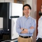 Yijun Sun, PhD (left), and Michael Buck, PhD, aim to better understand the interplay between the microbiome in the mouth and patients' health.