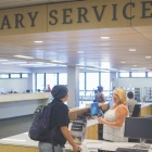 Student recieving help at the Library Services Desk on campus.