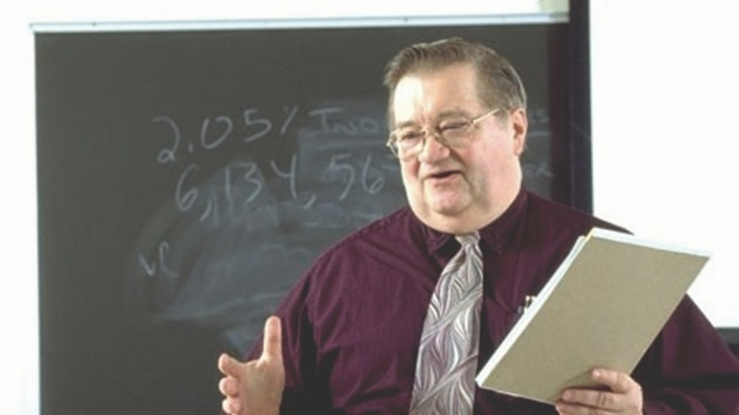 Professor Ronald J. Huefner teaching during lecture.