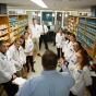 Pharmacy students listening to an instructor.