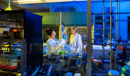 Zuiru Lin (left), a medicinal chemistry major, works in the lab of UB Distinguished Professor Janet Morrow (right).