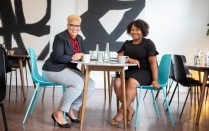 Greer Hamilton, MSW '16, BA '16, and Danise Wilson, MPH '14, sitting at a table.