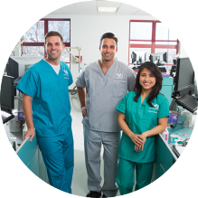 three dental students standing together