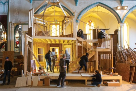Students work on restoring the nave of a church.