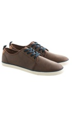 Brown leather shoes with navy blue shoe laces.