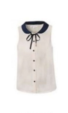 White sleeveless blouse with a black collar.