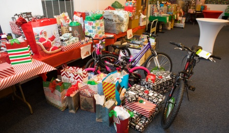 Image of presents on a table at Community Relations' Adopt a Family Event.