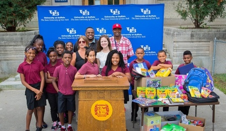 Photo of local students benefiting from UB's School Supply Drive.