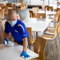 tables being cleaned by staff person.