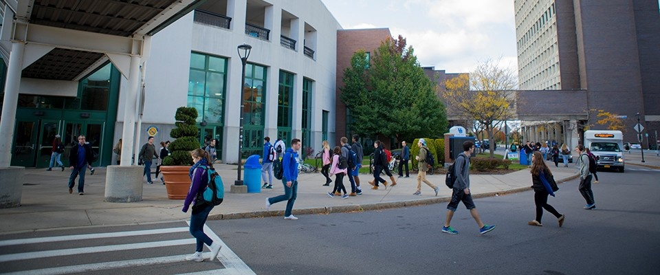 Students walking on the University at Buffalo's North Campus in the fall.
