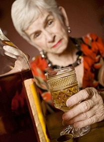 elderly woman drinking.