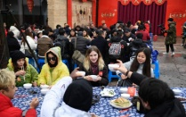 Overseas students attend a long-table feast marking the upcoming Chinese Lunar New Year in China on Jan. 4, 2020.