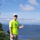 Michael Janak on top of McComb Mountain, one of the 46 Adirondack High Peaks. He has hiked 20 high peaks so far and hopes to hike all 46 before age 40.