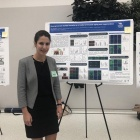 Nika Rajabian presenting her research at a poster presentation.
