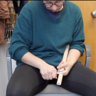 A still-shot from an instructional video in which Rebecca Biermann Gürbüz demonstrates how to make a wooden spear to participants.
