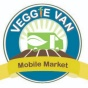 logo for the veggie van mobile market, a drawing of a green truck with a leaf and a carrot.