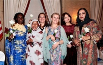 celebrated women from around the world are honored at a dinner.