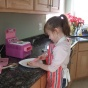 young girl makes a cake.