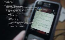 photo of cell phone with programming codes.