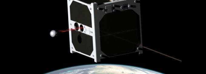 a cube-shaped satellite flies through space.
