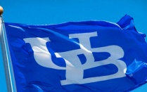 University at Buffalo flag flying. Blue with white letters: UB.