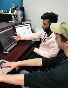 Two UB students working together at a computer.